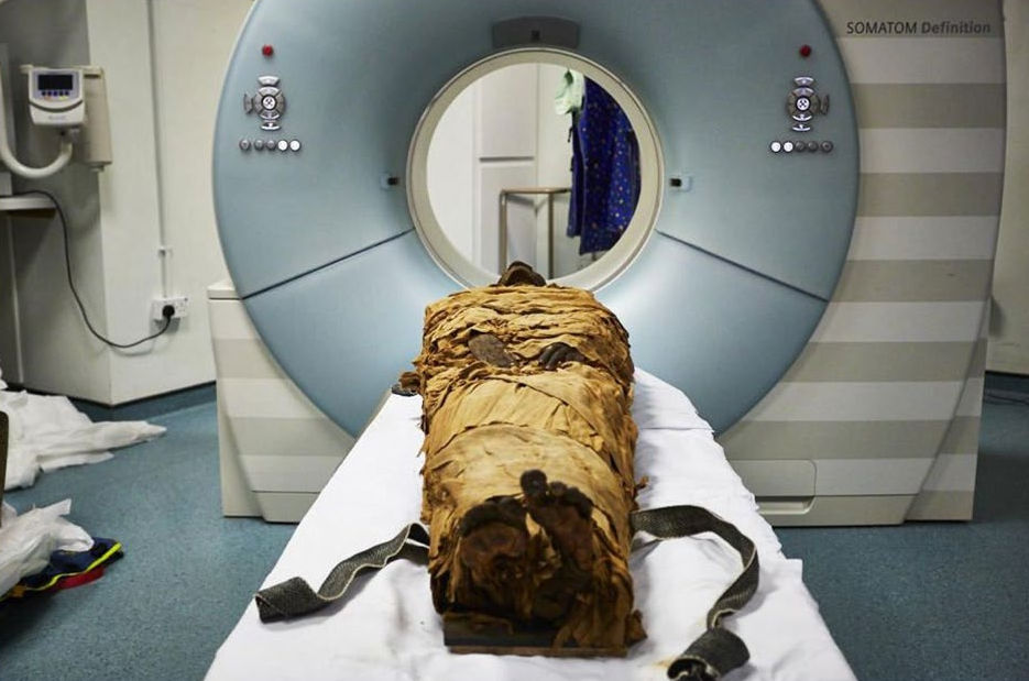 The mummified body of Nesyamun being prepared for a CT scan