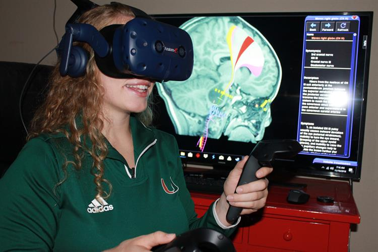 Woman using virtual reality device to visualize 3D images of brain MR