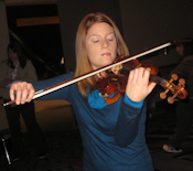 Violinist Brigid McCarthy plays the Betts copy.
