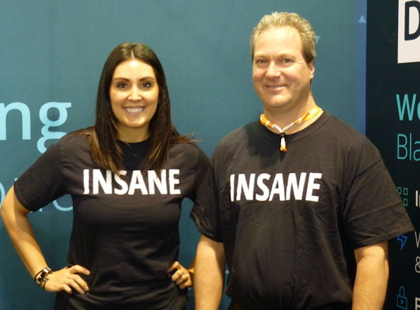 Woman and man wearing T-shirts showing the word insane on the front